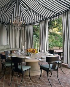 Formal outdoor dining area, use our brown ikea chairs, outdoor covers, outdoor table cloth, put up curtains.