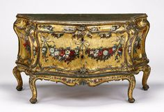 """1745-1750 Italian (Venice) Commode at the J. Paul Getty Museum, Los Angeles - From the curators' comments: """"Painted garlands of flowers, some suspended by tied ribbons, adorn the front and sides of this chest of drawers, or commode. An unknown craftsman silvered the scrolling molding and painted the top to simulate dark green marble. The curvilinear form, set on short curving legs with a carved foot, is typical of commodes from the mid-1700s that decorated the grand palaces of Venice."""""""