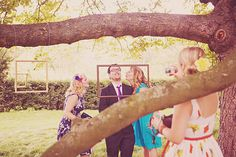 Love the idea of hanging frames from trees and using for guests photos.