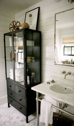 Use a furniture piece instead of linen closet in bathroom