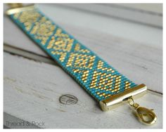Diamond Delica Beaded Loom Bracelet in Azure Blue & Gold by ThreadAndRock on Etsy https://www.etsy.com/listing/226796455/diamond-delica-beaded-loom-bracelet-in