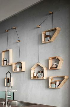 Cute way to store odds and ends; it's apparently called cantilated shelving!