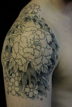 An unfinished peony tattoo with water and cherry blossoms.  I guess mine could be done!