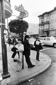 SAN FRANCISCO - 1967: Hippies dawdle at the corner of Haight and Ashbury Streets, the epicenter of the Summer of Love