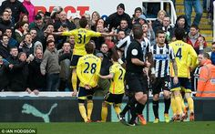 Rout: Fabio Borini celebrates in front of Newcastle fans as his team went on to repeat last year's 3-0 win, earning himself a booking.
