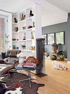 Delineate Spaces; In an open living room, create subtle division with a  shelving unit