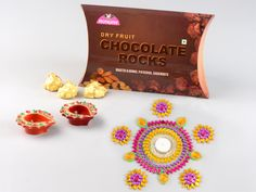 Monginis Food Pvt Ltd is the most trusted & biggest Cake brand in India since We are the largest manufacturers of Cakes, Pastries, packaged good and other baked products. Diwali Gift Hampers, Cake Branding, Chocolate Rocks, Diwali Celebration, Diwali Gifts, Big Cakes, Cake Shop, Dried Fruit, Delicious Chocolate