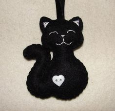 Hey, I found this really awesome Etsy listing at https://www.etsy.com/listing/238211308/lovely-wool-felt-cat-ornament-black-cat