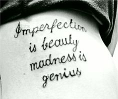 My rib tattoo: Imperfection is beauty madness is genius