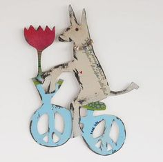 """PEDDLING PEACE POOCH--Handpainted, of recycled metal, this whimsical wall sculpture made by Jes Maharry and her husband Patrick brings peace into your home. Made in the USA. 12""""H x 15-1/2""""W."""