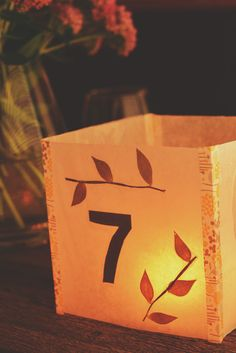 DIY Illuminated Table Numbers - Wax paper, dried leaves and washi tape.