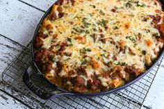 This is an easy baked ziti casserole with ground beef, Italian sausage and three kinds of cheese. This popular recipe is a full meal in one dish.