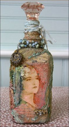 Create your own vintage bottle. Could use wine bottles! (also could cover wine bottle loosely with burlap-just tie at top and use to keep earrings on!
