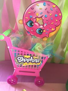 Shopkins Centerpiece Idea (Shopping cart $5-eBay, colored tulle -$3 Joanne's, Shopkins cut-out -$5 for 8 at Party City)