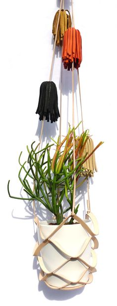 "handmade leather basket plant hanger with hand cut leather fringe multi-color tassels approx 45"" - fits pots with a 3-4 1/2"" base"
