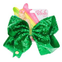 <P>Get into the spirit of St Patricks day this March with this super sassy green sequin hair bow from the JoJo Siwa collection. The bow has been attached to a metal salon clip making it really easy to wear and has been joined together with a gold studded gem keeper.</P><UL><LI>JoJo Siwa collection</LI><LI>Large green sequin St Patricks Day bow</LI><LI>Gold st...
