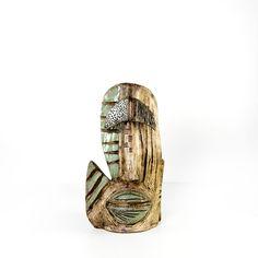 Scultura Polifemo. Opera realizzata in ceramica smaltata e patinata a bitume di giudea.