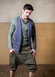 Cyberpunk Drop Armhole Gilet for Psytrance Rave Festival Wear in Post Apocalyptic Style Cube Gilet   The Cube Gilet Grey is the perfect combination for every men outfit It has a very cool flowy cut and built in pockets The stitching is giving the design an amazing structure The Gilet is made of