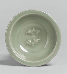 A 'LONGQUAN' CELADON 'TWIN FISH' SMALL DISH SOUTHERN SONG DYNASTY | Lot | Sotheby's