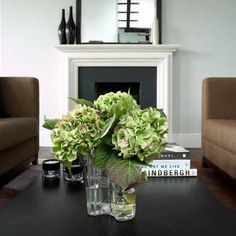 green hydrangea candles and coffee table books - Christian Liaigre