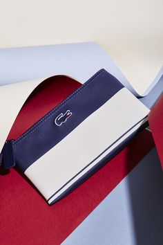 19e4051be0f95 Add a sailor s touch this Fall with our Lacoste accessories from the  Sailing North collection.