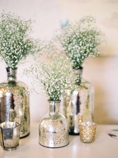 8 Winter Wedding Decor Trends You Can Plan for Now MERCURY GLASS Fill mercury vases with baby's breath (yes, it's back in style) or other white flowers to add height and texture to tables. Mercury Glass Centerpiece, Glass Centerpieces, Rustic Wedding Centerpieces, Centerpiece Ideas, Winter Centerpieces, Mercury Glass Wedding, Mercury Glass Decor, Table Decorations, Quinceanera Centerpieces