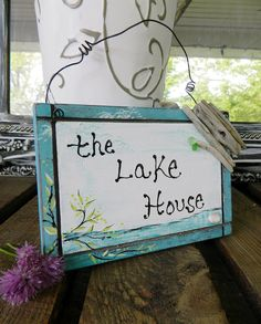 The Lake House Wood Sign Hand Painted With Sea Glass and Driftwood Unique Coastal Decor. $22.00, via Etsy.