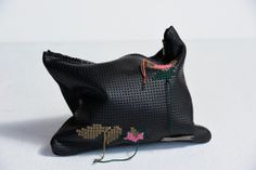 Needlepoint on black leather, edgy and cute, by Fumne, distributed by Gwelly's.