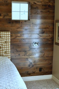 DIY wood plank wall.  This would be great for our kitchen island which is always getting mucked up by little fingers.