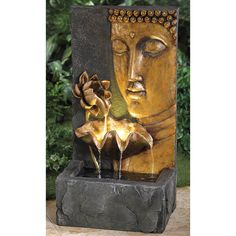 """This beautiful Buddha water fountain brings a tranquil touch to your indoor or outdoor setting. Water gently cascades from the 2 golden lotus flowers into the fountain's large basin. It's perfect for the patio, garden or living room!   a BrylaneHome® Exclusive! dimensions: 30""""H x 16""""W x 12""""D pump included; water recirculates through the fountain, no plumbing required polyresin UL Listed some assembly wipe clean imported beautify your outdoor space with our gorgeous selection of ..."""