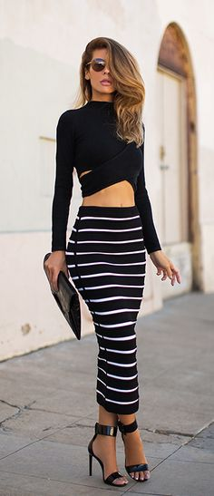 Jennifer Grace wearing a striped skirt outfit