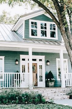 Blue Fixer Upper Oh the charm of a beautiful farm house. Take a step into this gorgeous Blue Fixer-Upper and be inspired.Oh the charm of a beautiful farm house. Take a step into this gorgeous Blue Fixer-Upper and be inspired. House Paint Exterior, Exterior House Colors, Exterior Design, Farmhouse Exterior Colors, Gray Exterior, Blue House Exteriors, Exterior Stairs, Exterior Paint Ideas, Siding Colors For Houses