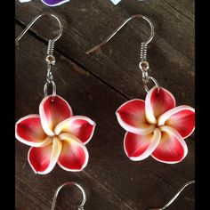 Red Hawaiian flower earrings These cute flower earrings are perfect for the spring and summer! The flowers are made of polymer clay and the hooks are silver plated. Check out my closet for more colors and other coordinating jewelry! Jewelry Earrings