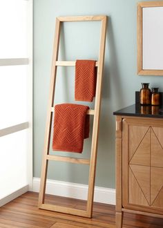 The Stokes Teak Ladder Towel Rack, from Signature Hardware, comfortably holds your bathroom towels and linens. Its ladder-style design is a charming addition to earthy, modern bathrooms.