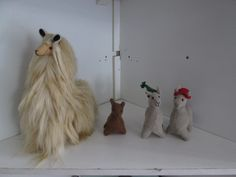 More llamas! little felt on in the middle and llamas with hats on the end, made out of cordouroy. One on the left is made out of alpaca fur, like silk.