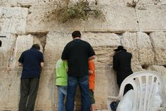 Bar Mitzvah journey to Jerusalem. Father and sons at the Western wall (Kotel)  Osnat Eldar SIGNATURE EVENTS