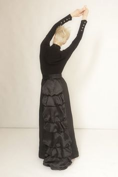Good example of a more historical bustle style skirt then some of the other references.