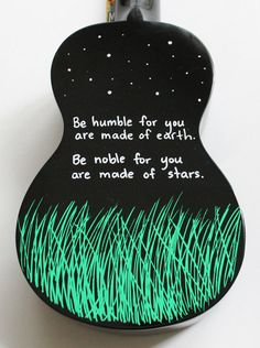 """Be humble for you are made of earth. Be noble for you are made of stars."" Black Mahalo ukulele, hand-painted by UkuLeeShee. $80.00 CDN on Etsy"