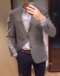Light grey sport coat, white shirt with light blue dress stripes, navy pants