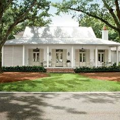 Creole-French-style cottage beckons visitors in with an easygoing porch and a simple, modern design - Breezy River House Exterior - Southern Living Style At Home, Future House, My House, House Porch, Farm House, House Front, Boat House, Cottage House, Exterior Paint Colors