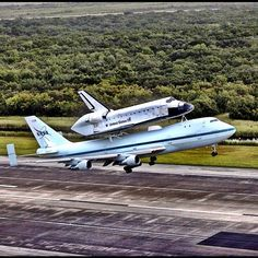 Space shuttle Endeavour takes to the sky from the Shuttle Landing Facility at NASA's Kennedy Space Center in Florida at 7:22 a.m. EDT mounted atop NASA's Shuttle Carrier Aircraft, or SCA. In the background is the 525-foot-tall Vehicle Assembly Building where the shuttles were attached to their external fuel tank/solid rocket booster stacks. The SCA, a modified 747 jetliner, will fly Endeavour to Houston and then to Los Angeles where it will be placed on public display at the California…
