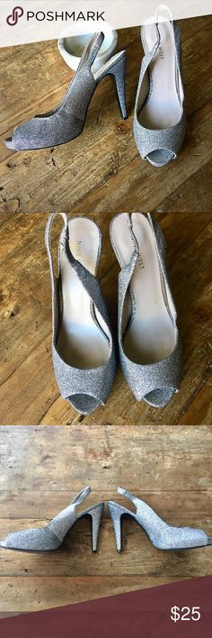 "✨ Nine West Glitter Peep Toe Slingback Heels Silver slippers that would make Cinderella jealous. ✨ These babies are unique in that they are sparkle on every outer surface, even the heel itself! Peep toe, slingback style with about a 4"" heel & 1/2"" platform. Worn one to a military ball & they've been sitting in the closet needing another night on the town! Light wear on the right heel where a sticker was, & gentle wear on inner lining of right toe area from sitting around (all shown in pics)…"
