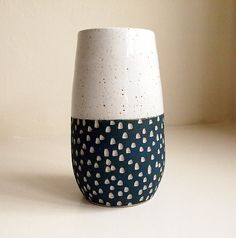 Black glaze on top of white speckled glaze, with wax resist etchings in white