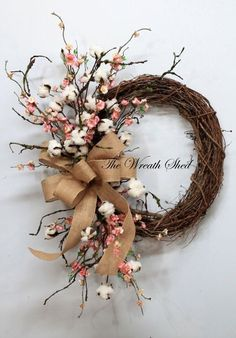 blossom cotton boll wreath / http://www.himisspuff.com/wedding-wreaths-ideas/2/