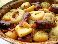 Dublin Coddle - Irish Sausage, Bacon, Onion and Potato Hotpot  Ingredients     2 kg potatoes     2 large onions, peeled and sliced thickly     450 g good quality pork sausages     450 g bacon, piece thick cut     500 ml water     1 ham stock cube or 1 beef or 1 chicken stock cube, if ham stock isn't available     3 -4 tablespoons fresh parsley, chopped     salt (to season)     coarse-ground pepper (to season)  Directions     Peel the potatoes. Cut large ones into three or four pieces: leave ... Irish Sausage, Irish Bacon, Sausage Potatoes, Bacon Sausage, Bacon Potato, Potato Onion, Irish Potato Soup, Onion Soups, Veggie Sausage