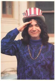 Captain Trips, nickname for Jerry Garcia - the r,w 'top hat' was his Capt. Trips hat. The nick-name came from the 'trips' he and the musicians took when Jerry went 'off'' on his long guitar psychedelic 'adventures' in many songs preformed live. Photo is from 1968 taken outside their house at 710 Ashbury Street, (in the Height district), San Francisco.