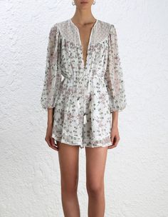 Eden Web Dot Playsuit, from our Summer Swim 16 collection, in Floral embroidered silk crinkle georgette. Circle insert trim detail through sleeve and at hem. Tie detail neckline, removable self tie belt. Full length blouson sleeve with elastic cuff. Lined.