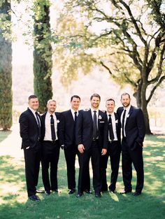 Black suits for this group..  Read more - http://www.stylemepretty.com/2014/01/07/classic-charles-krug-winery-wedding/