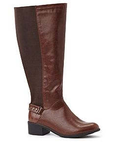Stylish riding boot adds western appeal to your favorite outfits. Wide width and wide calf design gives you a custom fit, with comfortable, stretch fabric at the back of the calf and on the sides. Metallic studs accent the back ankle strap. Thick heel is a sturdy and dependable detail. Complete with a convenient, full zip opening on the side of the leg. For your comfort, Catherines boots come in wide width sizes with stretchable calves to better fit the plus size woman.