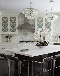 Two modern, bling chandeliers in new kitchen